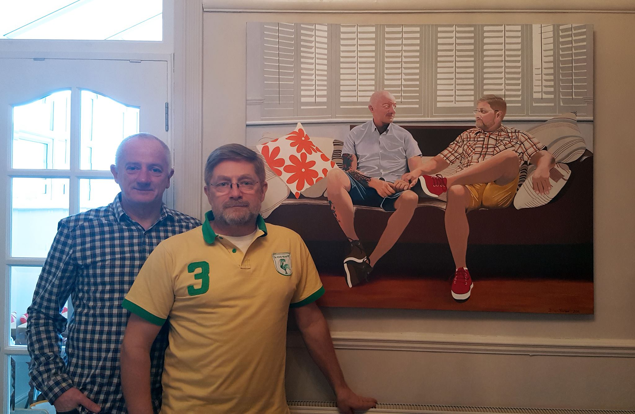 """Commisioned portrait of Dan and Steve entitled """"Husbands"""" on show in their living room."""